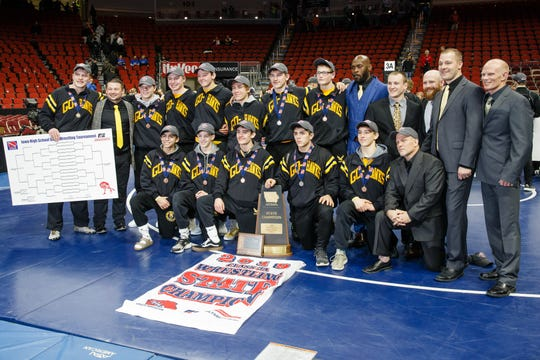 Waverly-Shell Rock poses for a photo after winning the 3A traditional team championship at the Iowa state wrestling championships on Saturday, Feb. 16, 2019 in Des Moines.