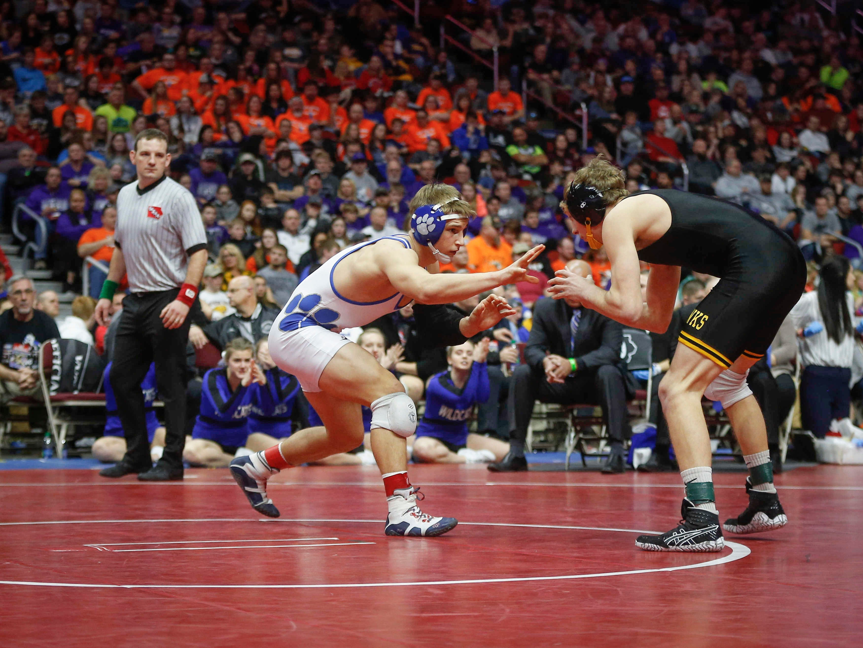 Woodbury Central junior Wade Mitchell, left, battles Emmetsburg senior Spencer Griffin en route to a Class 1A state title win at 145 pounds on Saturday, Feb. 16, 2019, at Wells Fargo Arena in Des Moines.