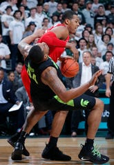 Ohio State's Kaleb Wesson works against Nick Ward during the first half of Michigan State's 62-44 win Sunday, Feb. 17, 2019, in East Lansing.