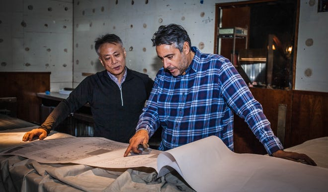Chefs Takashi Yagihashi, left, and Luciano Del Signore review blueprints for their new fine dining restaurant Pernoi, set to debut in Birmingham spring 2019.
