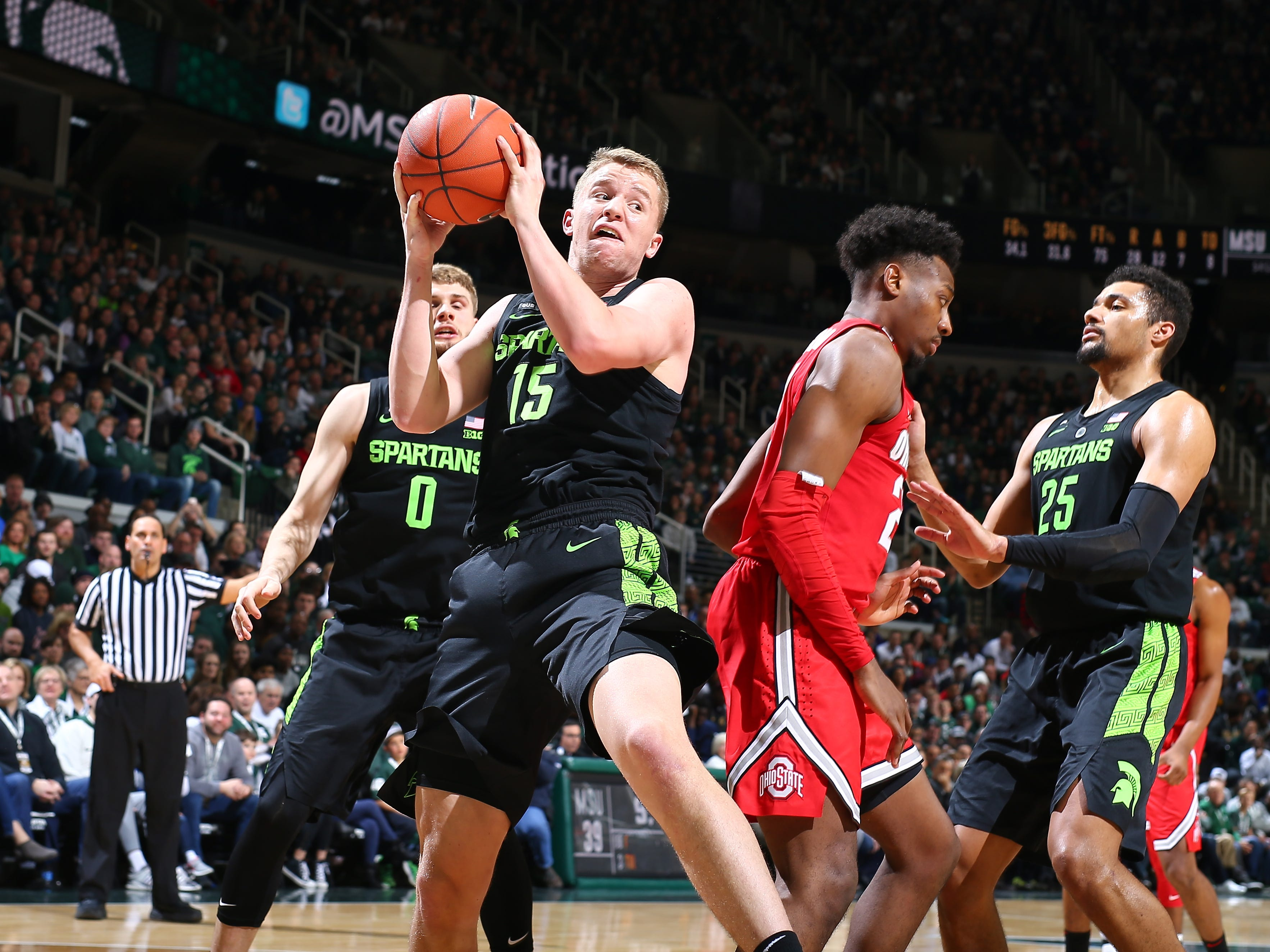 Michigan State's Thomas Kithier rebounds in the second half of the 62-44 win over Ohio State on Sunday, Feb. 17, 2019, in East Lansing.