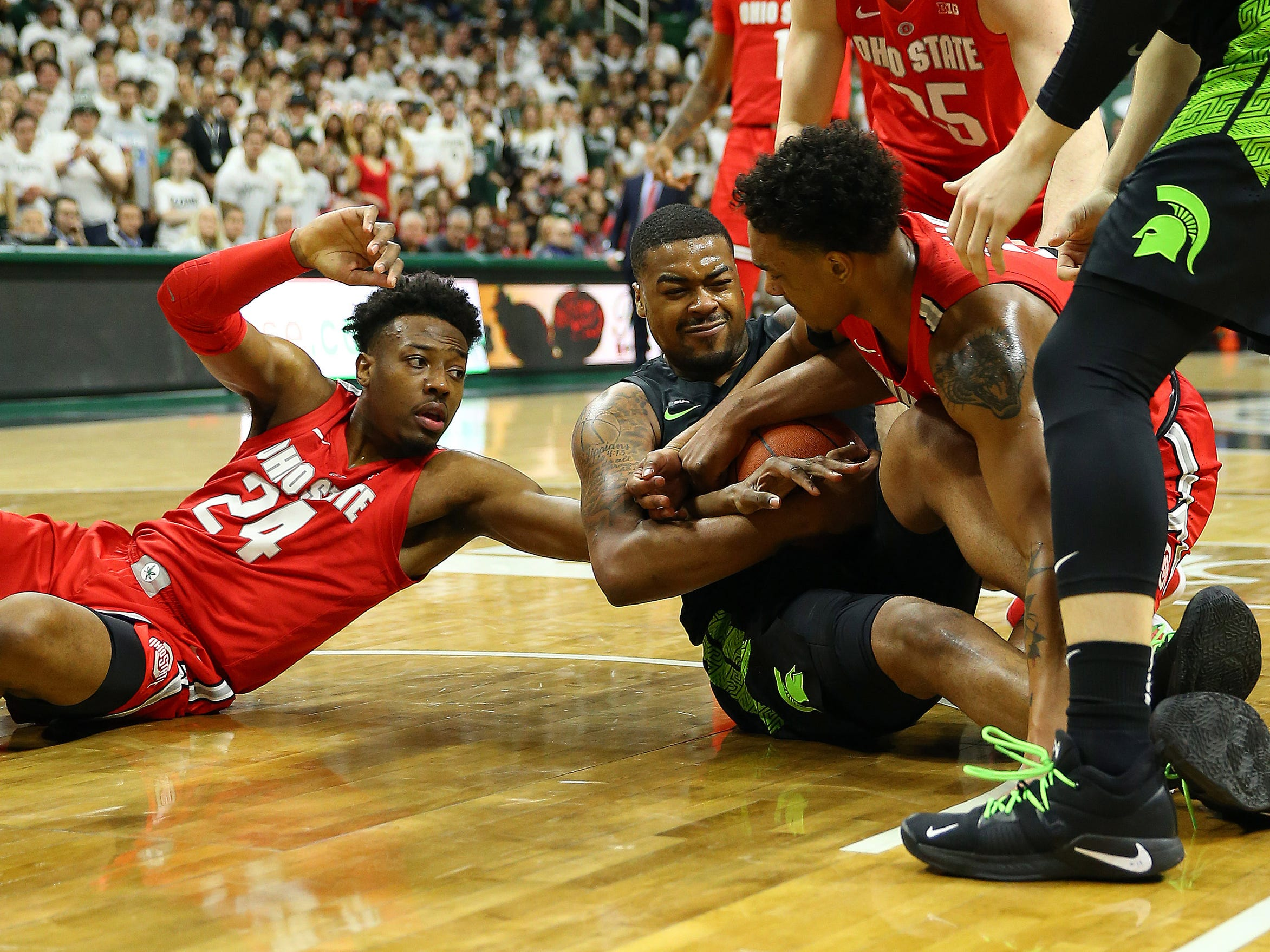 Michigan State's Nick Ward fights for a loose ball against Ohio State in the first half Sunday, Feb. 17, 2019, in East Lansing.