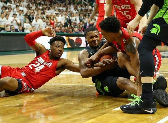 Nick Ward fights for a loose ball in the first half Sunday.