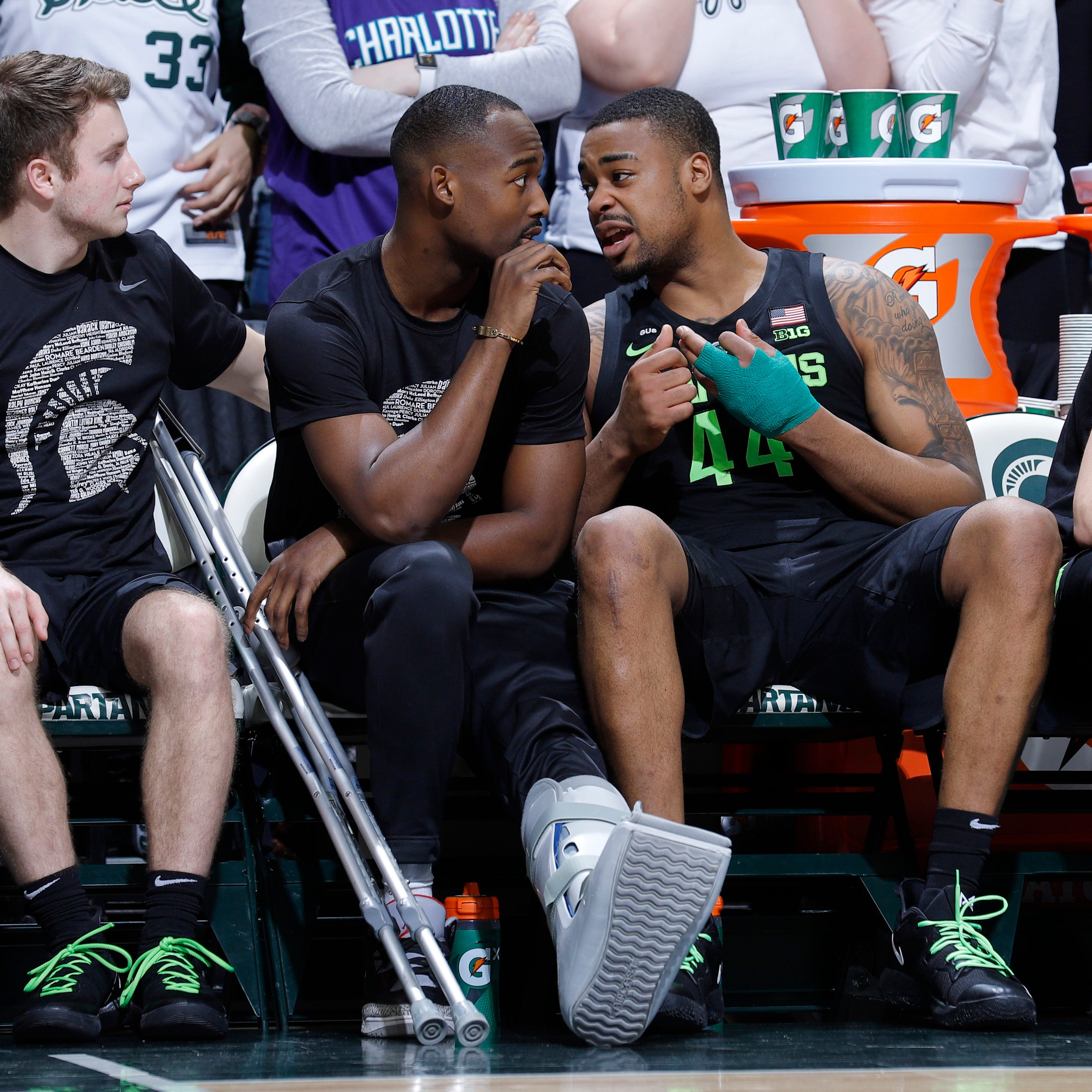 Michigan State's Nick Ward, right, talks with...