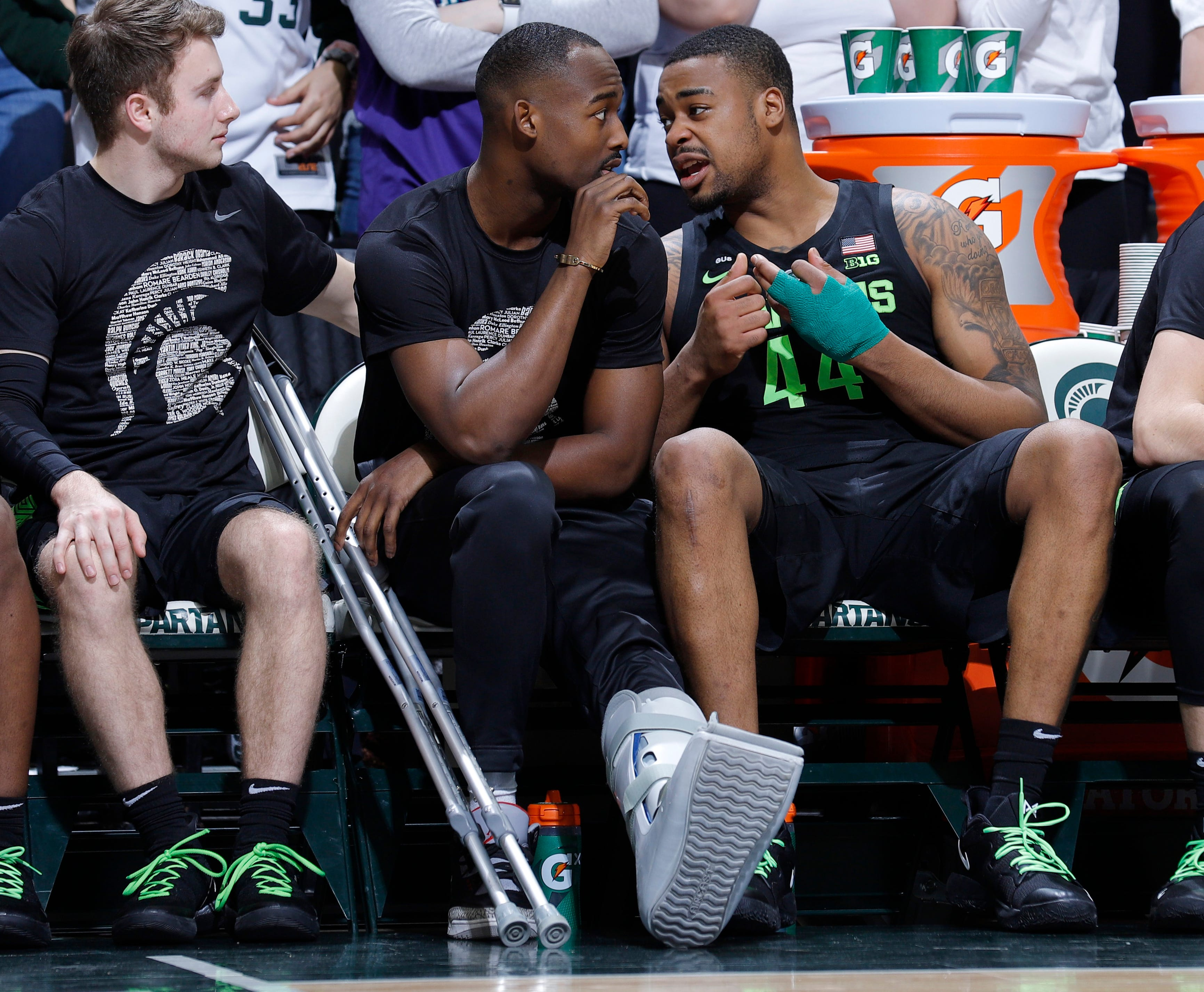 Michigan State's Nick Ward, right, talks with Joshua Langford while on the bench during the second half of his team's game against Ohio State.