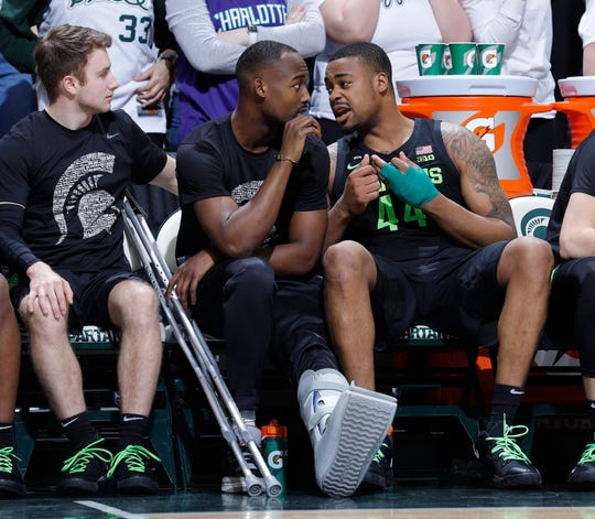 Nick Ward, of Michigan State, right, talks with Joshua Langford, center, and Jack Hoiberg, left, while he was on the bench during the second half of the year. NCAA College Basketball Game against Ohio State on Sunday, February 17, 2019 in East Lansing, Michigan