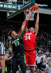 Ohio State's Kaleb Wesson, right, shoots and draws a foul against Michigan State's Xavier Tillman during the first half on Sunday, Feb. 17, 2019, in East Lansing.