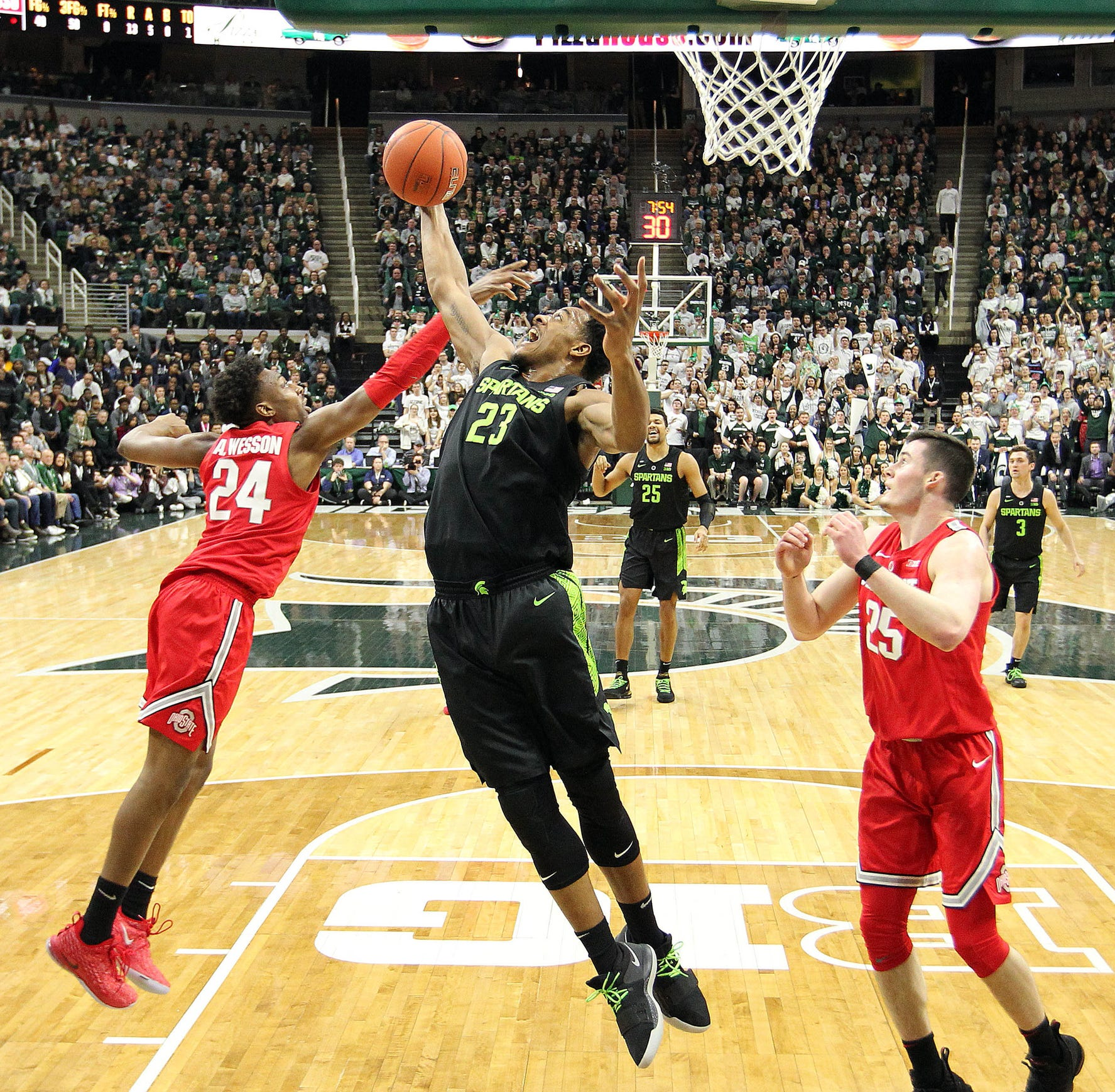 Xavier Tillman grabs a rebound over Ohio State's Andre Wesson during the first half of MSU's 62-44 win Sunday.