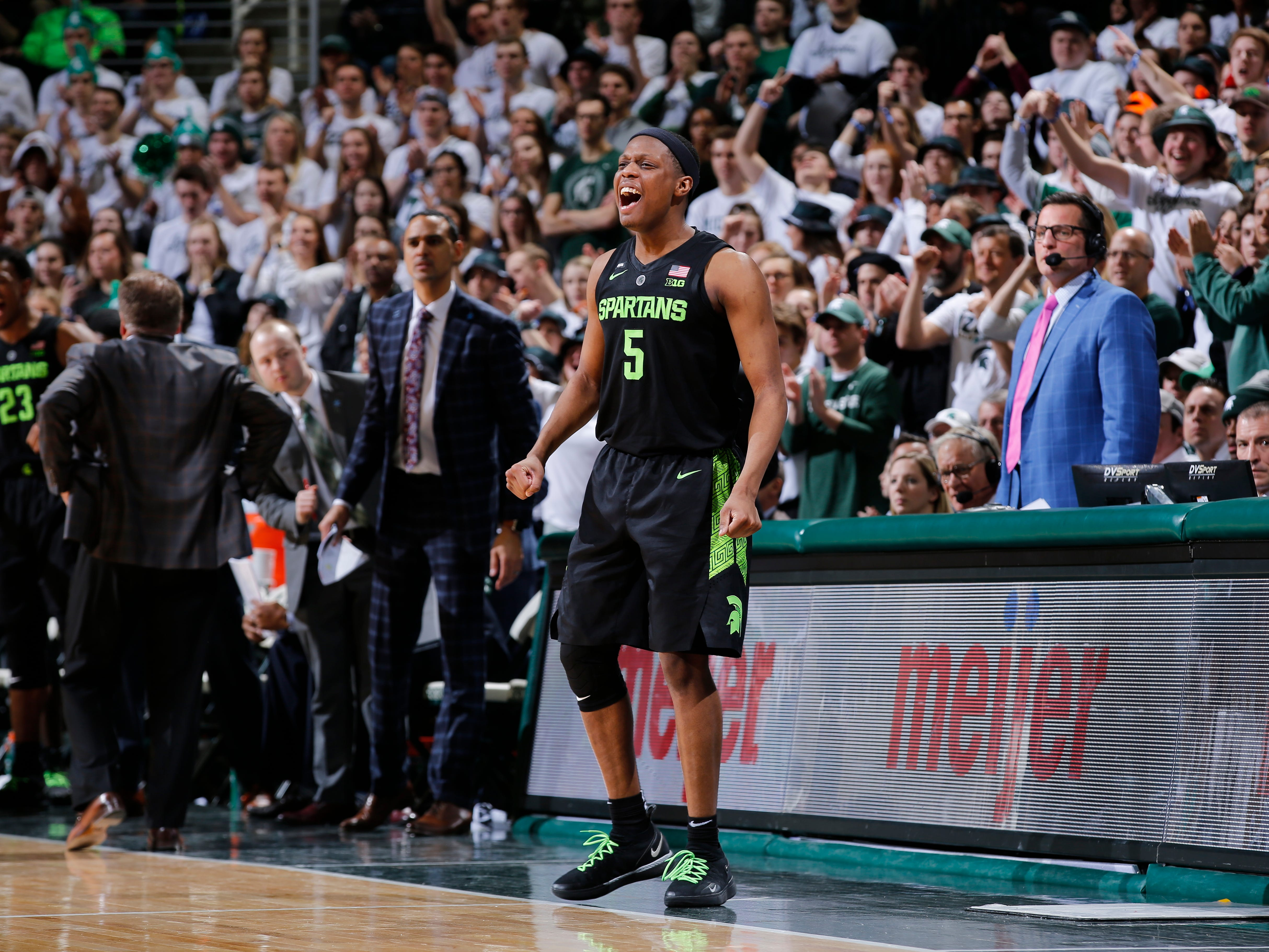 Michigan State's Cassius Winston celebrates from the sidelines during the second half of MSU's 62-44 win Sunday, Feb. 17, 2019, in East Lansing.