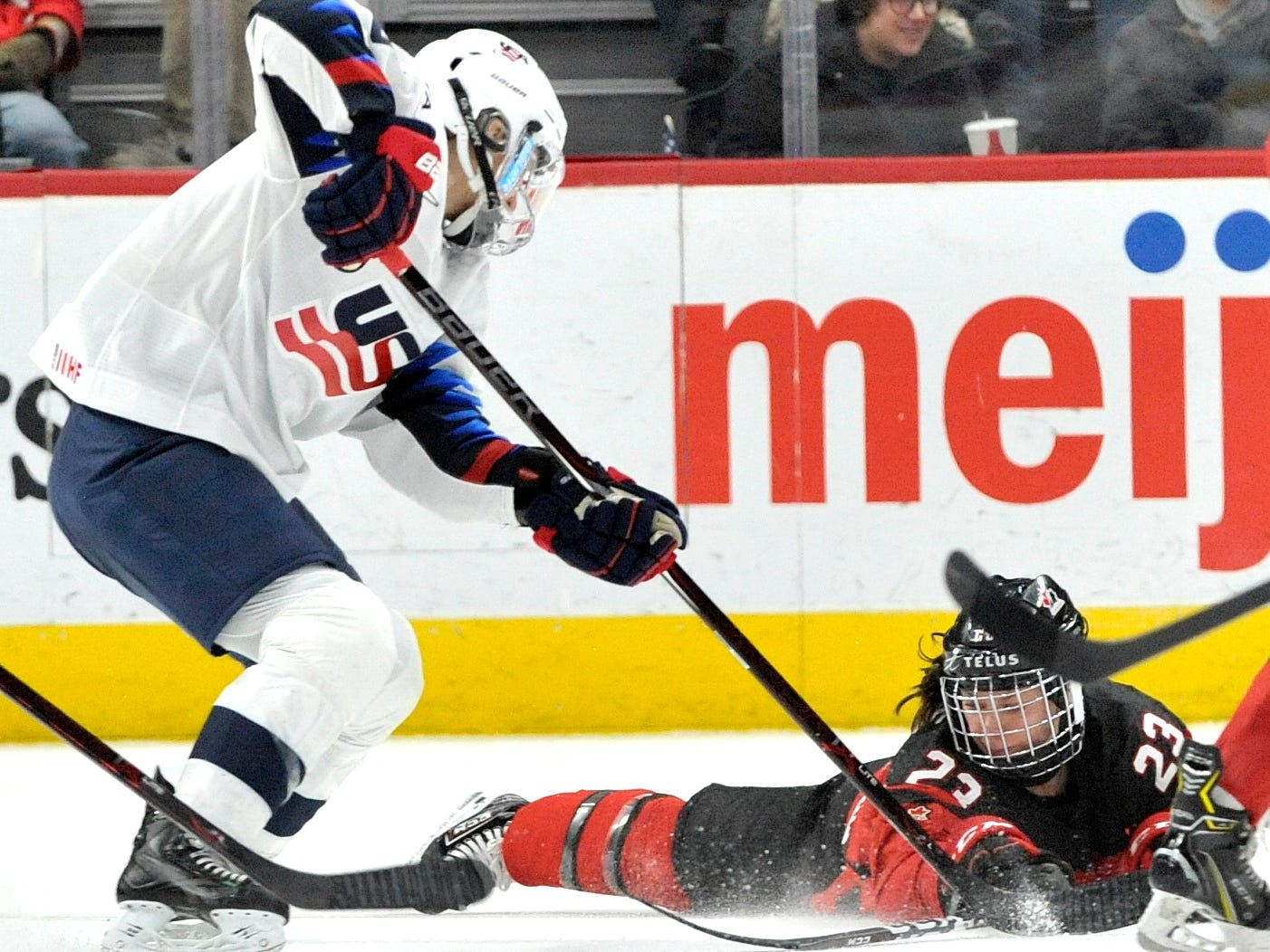 U.S's Hayley Scamurra(16) and Canada's Erin Ambrose(23) fight for the puck in the second period.