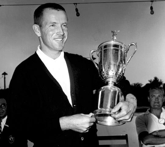 In this June 17, 1961, file photo, Gene Littler holds the trophy after winning the U.S. Open golf tournament at Oakland Hills in Birmingham. Littler, whose fluid swing carried him to 29 victories on the PGA Tour and a U.S. Open title, died Friday night with his family at his side. He was 88.