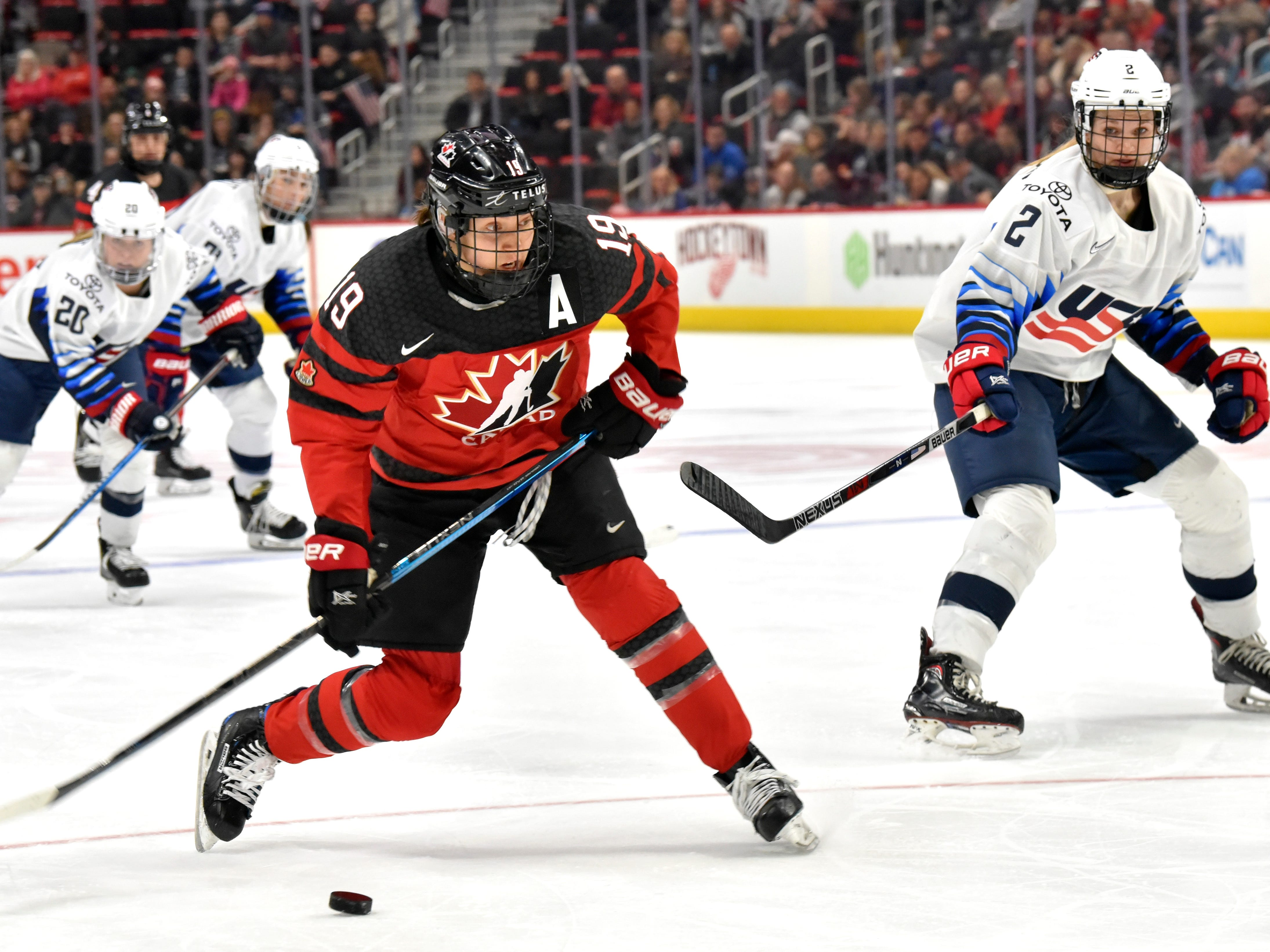 Canada's Brianne Jenner(19) shoots the puck with U.S's Lee Stecklein(2) nearby in the second period.