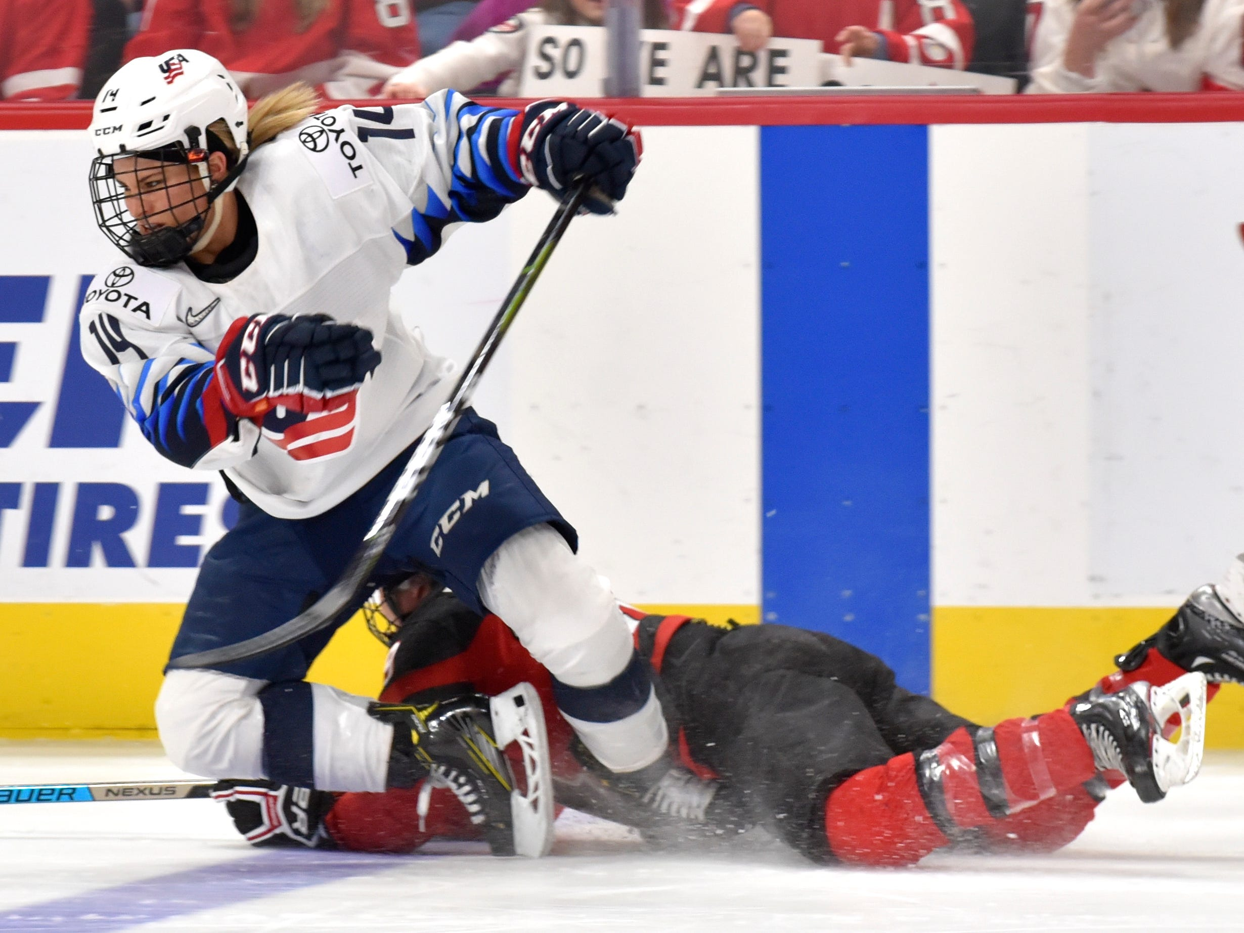 U.S's Brianna Decker(14) and Ann-Sophie Bettez(39) tangle for the puck in the third period.
