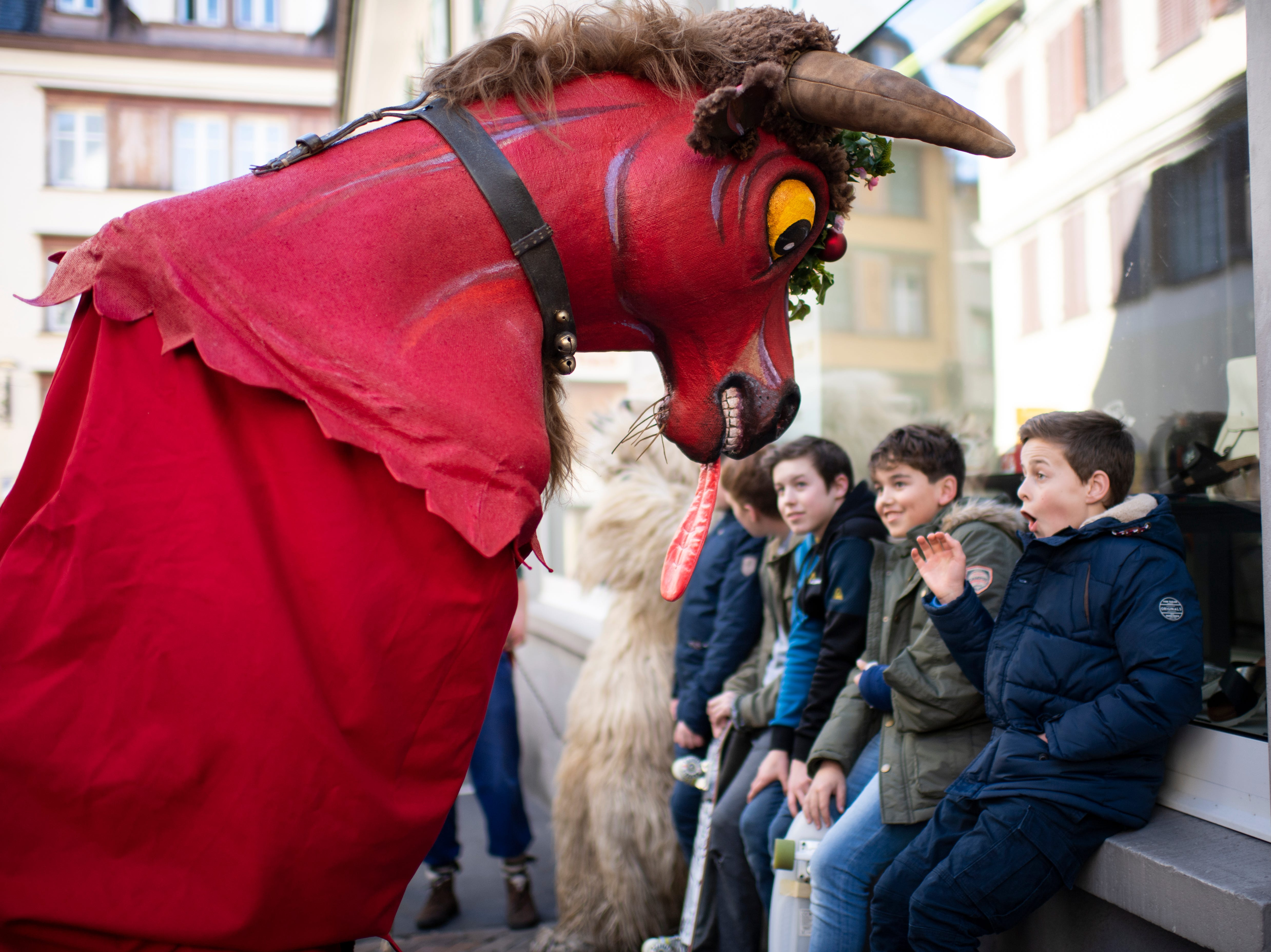 """The German carnival group """"Endinger Narrenzunft"""" perform during the European cultural custom meeting in Atlstaetten, Switzerland Saturday, Feb. 16, 2019. The meeting is held on the 100th anniversary of local carnival group """"Roellelibutzen Verein,"""" and brings together about 2,000 participants from carnival groups from all over Europe."""