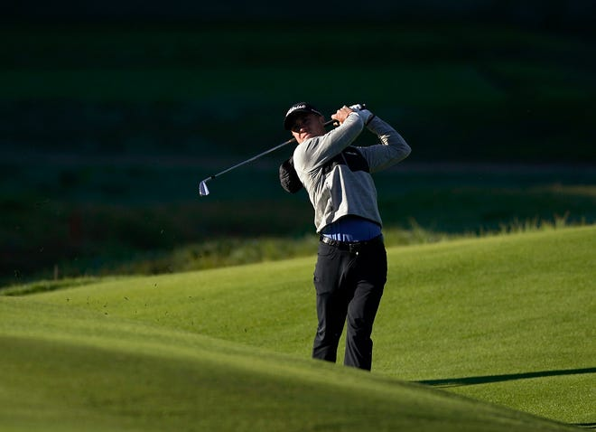 Justin Thomas watches his second shot from the eighth fairway as second round play continues during the Genesis Open golf tournament at Riviera Country Club on Saturday.