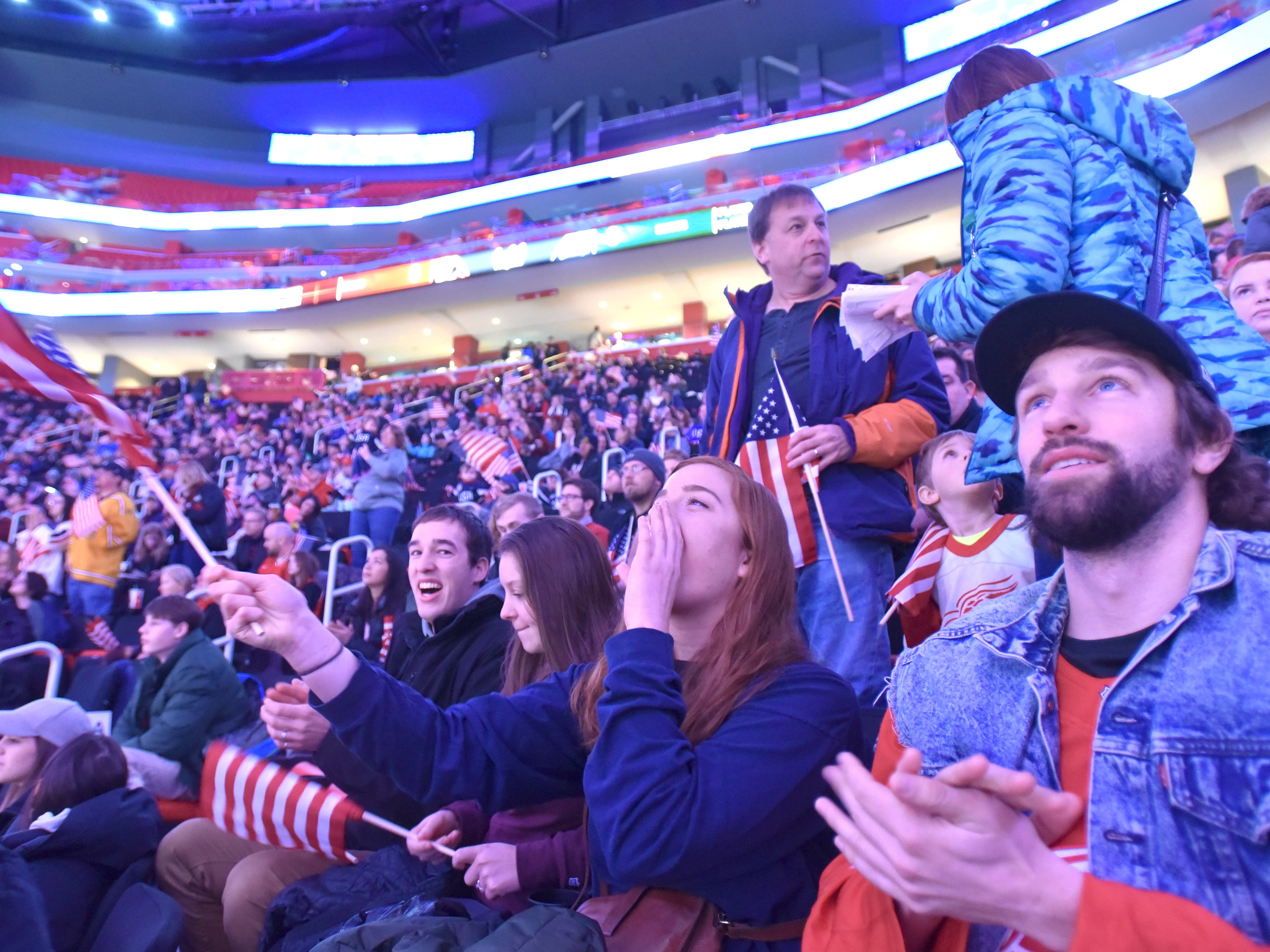 U.S. fans cheer for their team during warmups before the U.S. Women's National Hockey Team and Canada's National Women's Team match at Little Caesars Arena in Detroit during the 2019 Rivalry Series, Sunday afternoon, February 17, 2019.