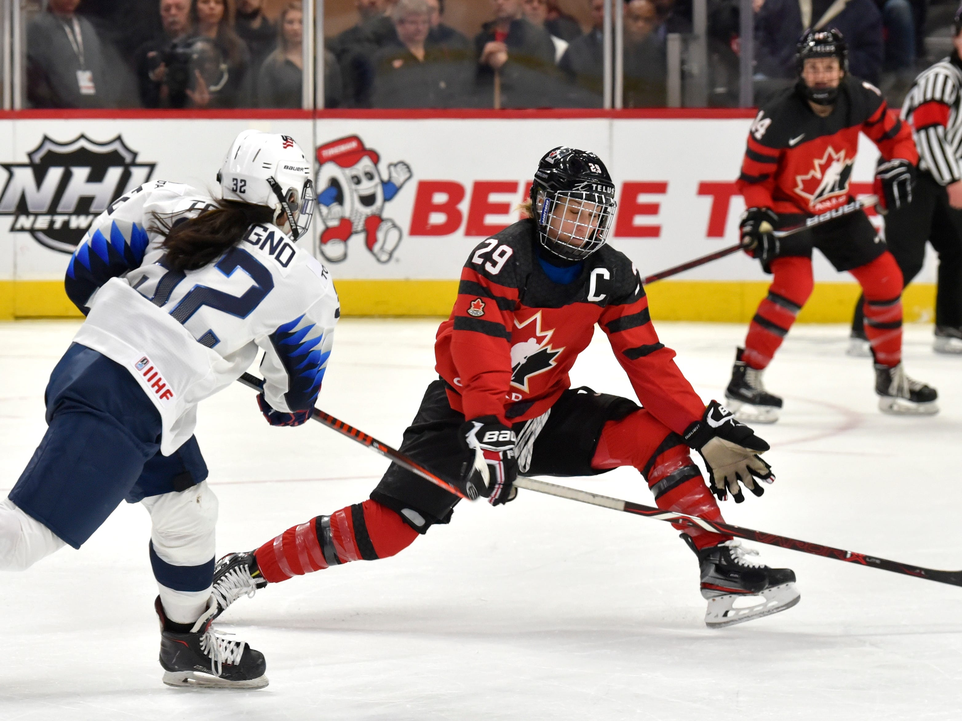 U.S's Dana Trivigno(32) shoots as Canada's Marie-Philip Poulin(29) tries to block the puck near the end of the match.