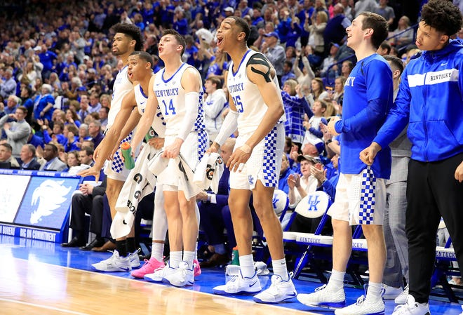 The Kentucky bench celebrates amid an 86-69 win against top-ranked Tennessee.