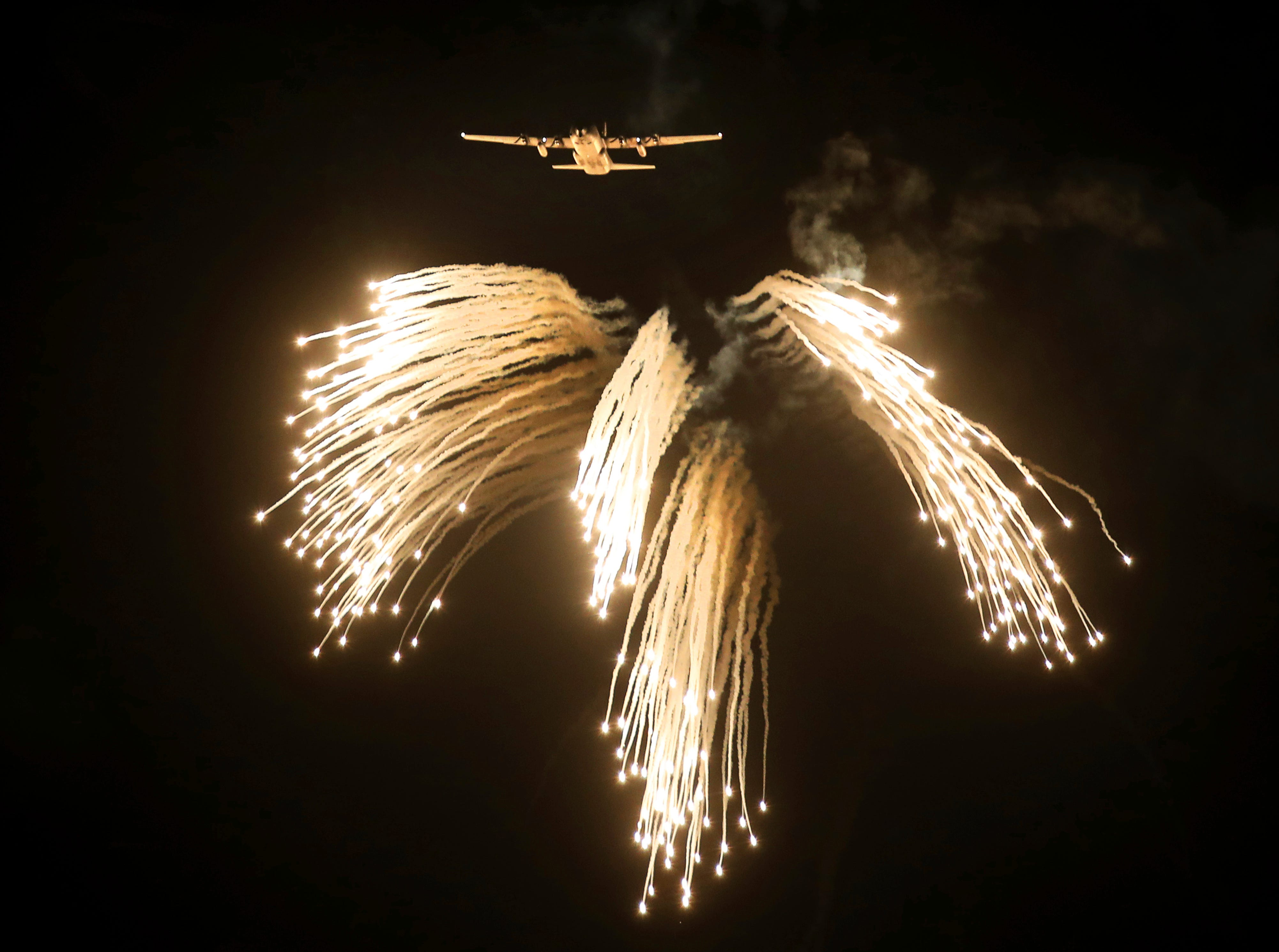 An Indian Air Force C-30J dispenses flares during an air exercise named 'Vayu Shakti-2019', or air power, at Pokhran, in the western Indian state of Rajasthan, Saturday, Feb. 16, 2019. The IAF carried out an exercise near the border with Pakistan, showcasing indigenously-developed Light Combat Aircraft (LCA) Tejas, Advanced Light Helicopter (ALH) , the Akash surface-to-air missile and Astra air-to-air missile, among others.