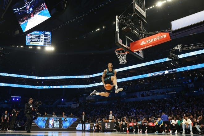 Former Spartan Miles Bridges of the Charlotte Hornets goes up for a dunk.