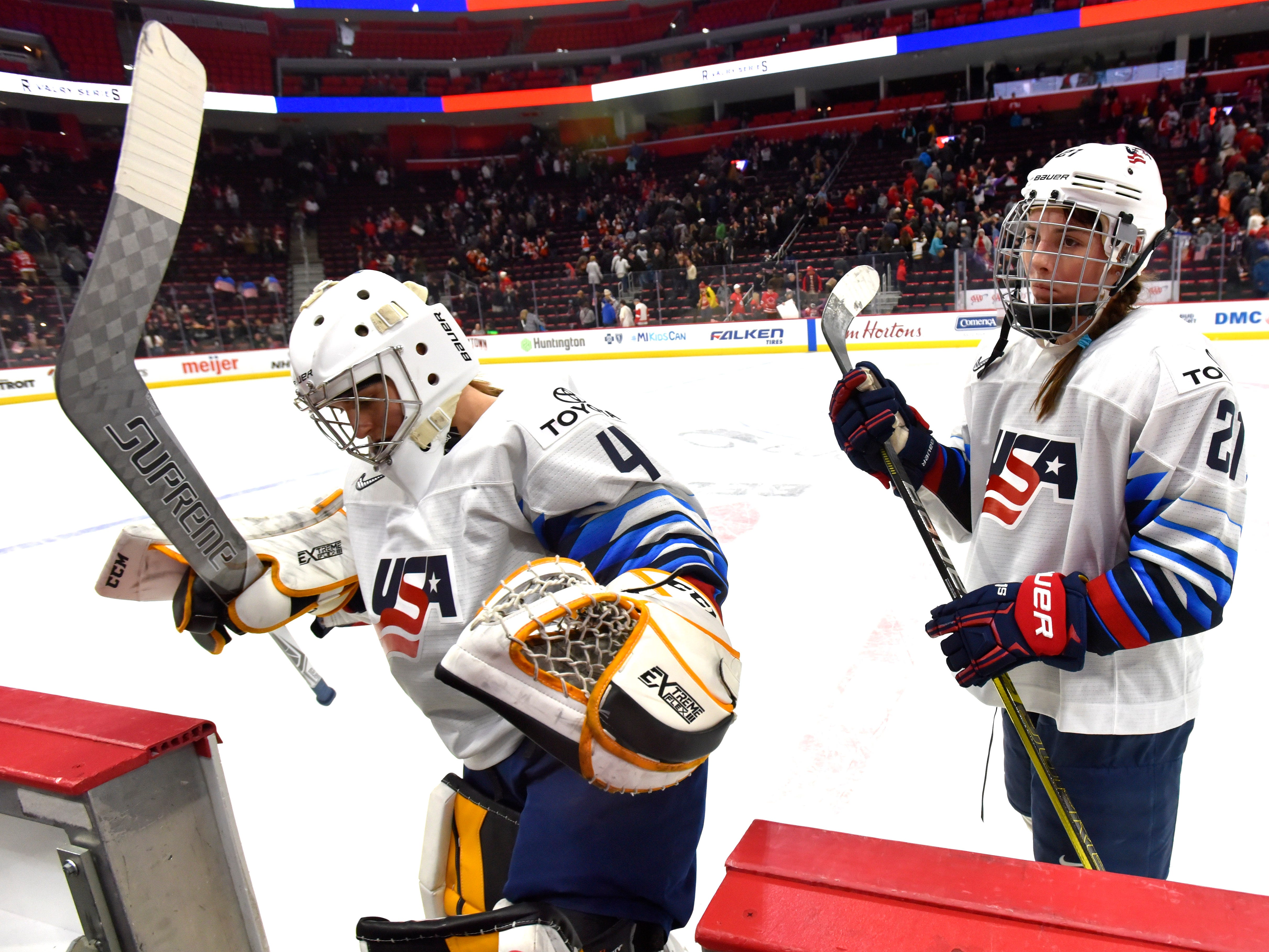 U.S. goalie Katie Burt(41) and teammate Hilary Knight(21) leave the ice after their 2-0 loss to Canada's National Women's Team.