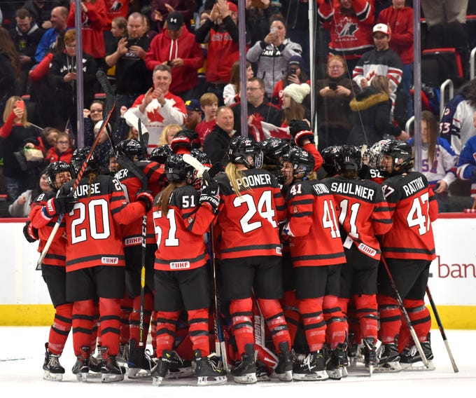 Canada's National Women's Team celebrates their 2-0 win over the U.S.  Women's National Hockey Team at Little Caesars Arena in Detroit during the 2019 Rivalry Series, Sunday afternoon, February 17, 2019.