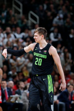 40b21b0385a5 Michigan State s Matt McQuaid reacts during the second half of an NCAA  college basketball game against