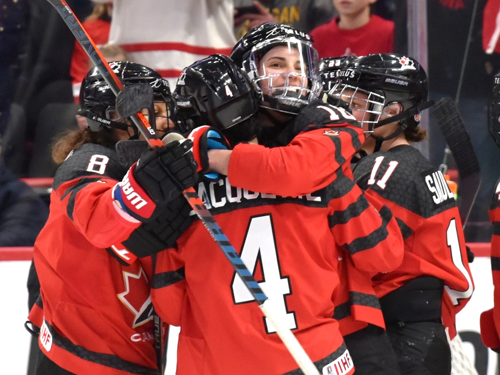 Members of Canada's National Women's Team celebrate their win over the U.S., 2-0.