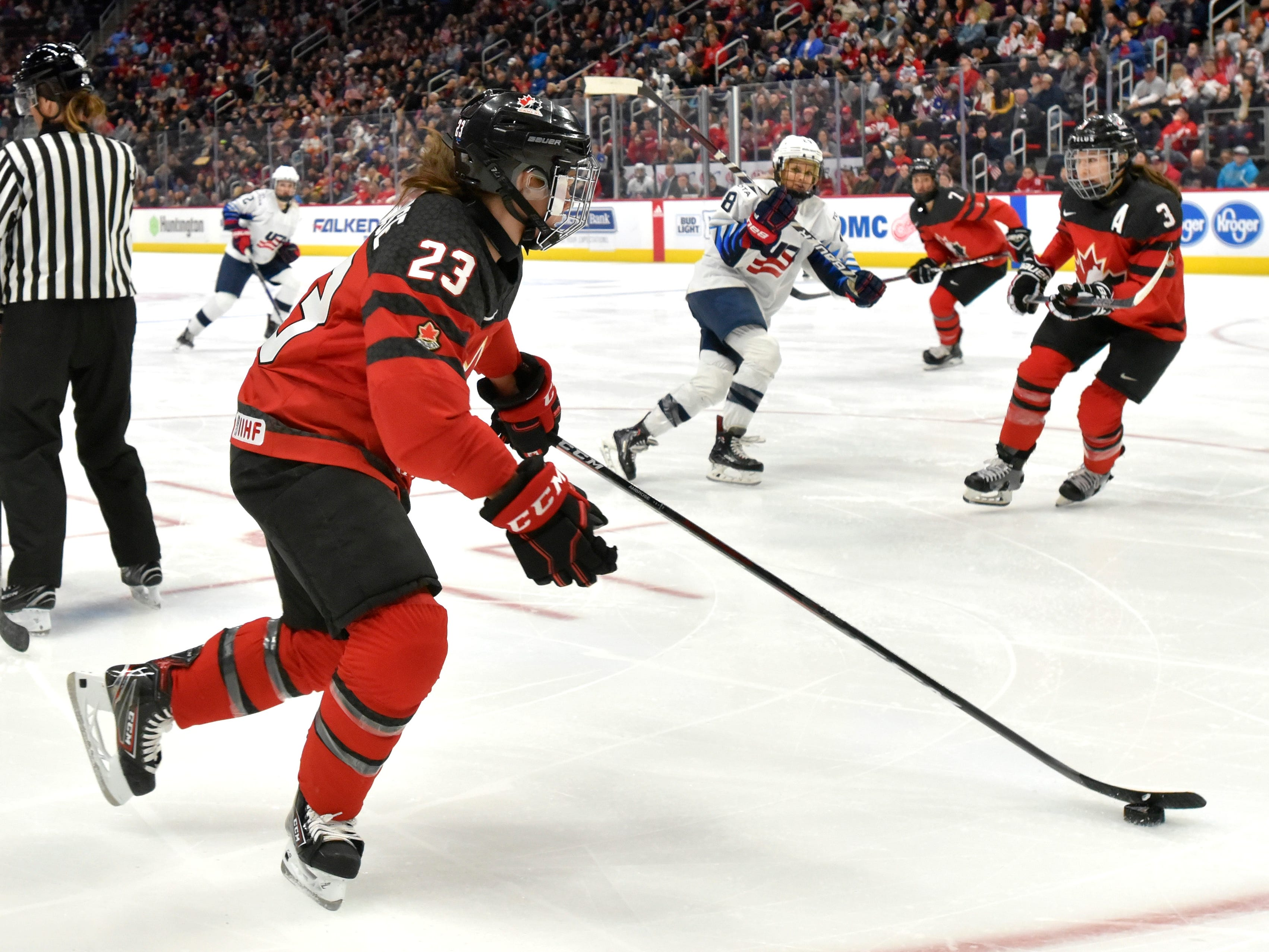 Canada's Erin Ambrose(23) skates away with the puck after a face off in the first period.