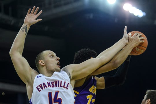University of Evansville's Dainius Charkevicius (14) and University of Northern Iowa's Trae Berhow (11) fight for the rebound during the first half at Ford Center in Evansville, Ind., Sunday, Feb. 17, 2019.