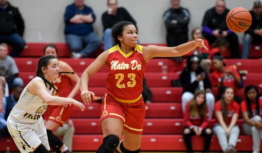 Mater Dei's Mariah Dickerson looks for the poll in the semistate last year against Winchester. The Wildcats face Linton-Stockton in the Paoli Regional on Saturday.