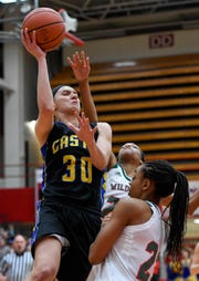 Castle's Jessica Nunge (30) shoots over Lawrence North's Jayla Smith (24) in the Knights' 50-40 loss Saturday in the Class 4A Jeffersonville Semistate.