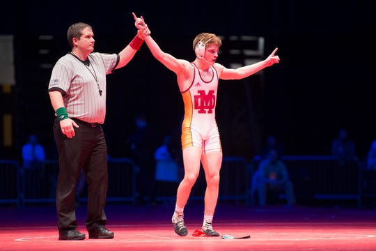Evansville Mater Dei's Matthew Lee celebrates after beating Alex Mosconi in the 145 lbs. IHSAA State Wrestling Championship match at Bankers Life Fieldhouse on Saturday, Feb 16, 2019.