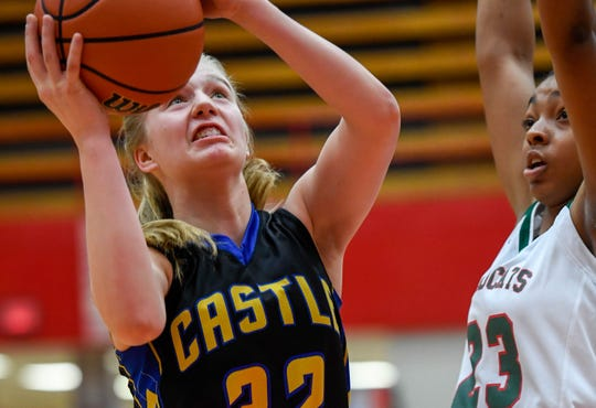 Castle's Natalie Niehaus (32), shooting in a Class 4A semistate loss to Lawrence North, could be the top SIAC girls' basketball player as a sophomore.