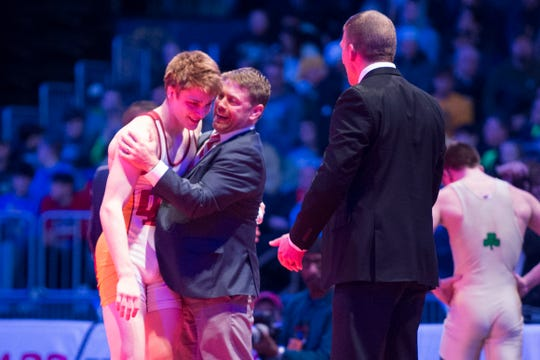 Evansville Mater Dei's Matthew Lee celebrates with Coach Greg Schaefer after beating Alex Mosconi in the 145 lbs. IHSAA State Wrestling Championship match at Bankers Life Fieldhouse on Saturday, Feb 16, 2019.