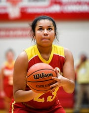 Mater Dei's Mariah Dickerson (23) concentrates on a first half free throw as the Evansville Mater Dei Wildcats play the Winchester Community Golden Falcons in the Class 2A Girls Semi-State Tournament at Jeffersonville High School Saturday, February 16, 2019. Dickerson was huge down the stretch for the Wildcats on Saturday night.