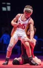 Evansville Mater Dei's Blake Boarman wrestles Brayden Littell in the 120 lbs. IHSAA State Wrestling Championship match at Bankers Life Fieldhouse on Saturday, Feb 16, 2019.