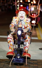 Clowns and more appear in the Edison Festival of Light Grand Parade every year.