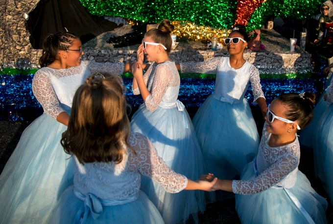 Dancers with the Bayshore Cloggers have fun together before the start of the Edison Festival of Light Grand Parade on Saturday, Feb. 16, 2019, at the staging area at  Fort Myers High School.