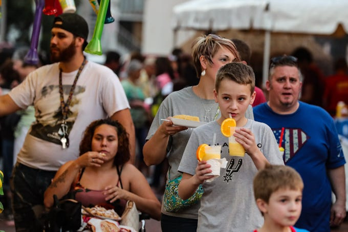 You showed up early for the Edison Festival of Lights Grand Parade in Downtown Fort Myers, Florida. What did you munch on while you waited for the parade to start?