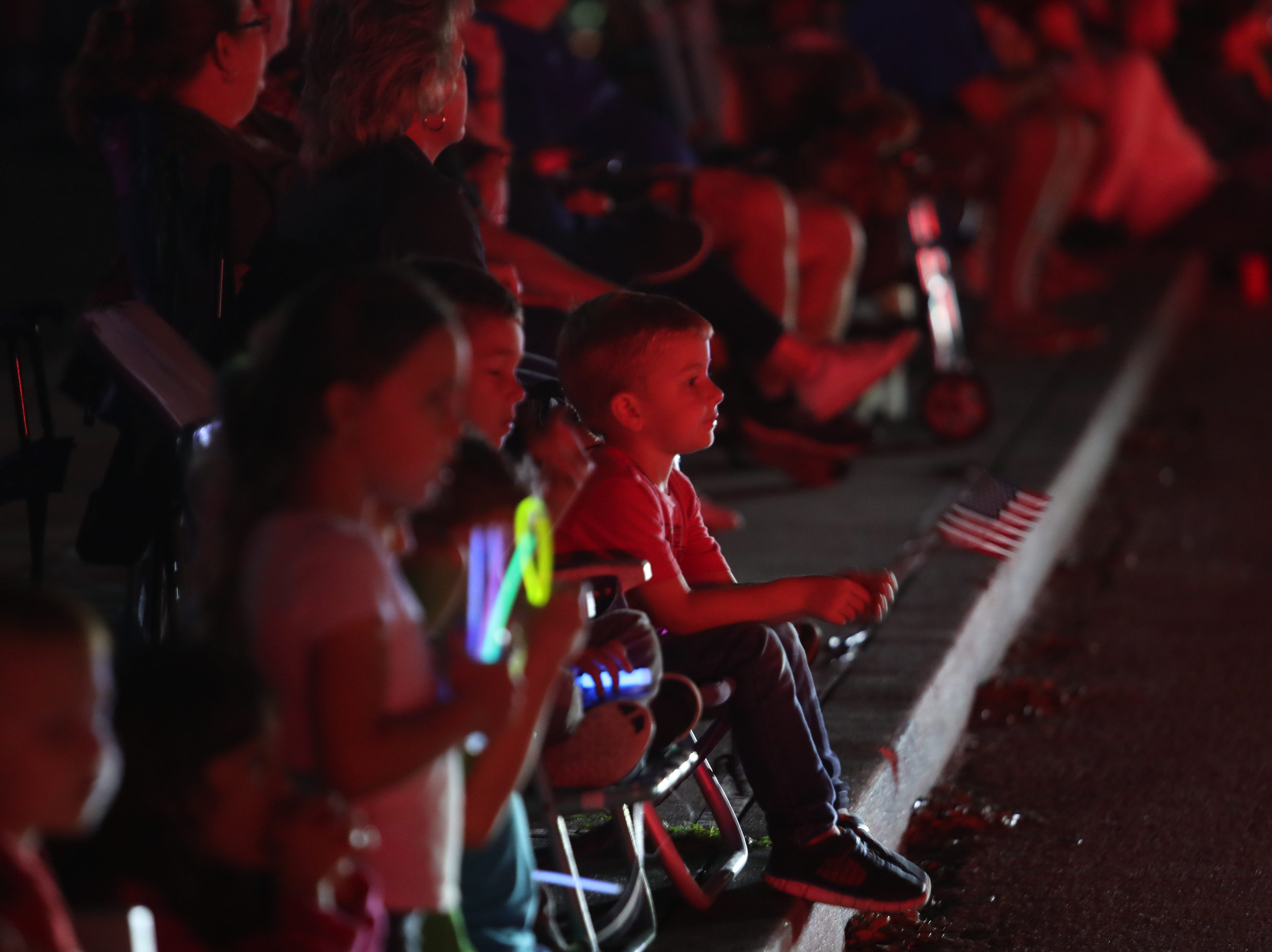 Spectators watch the Edison Festival of Light Grand Parade move along Cortez Boulevard in Fort Myers on Saturday, Feb. 16, 2019.