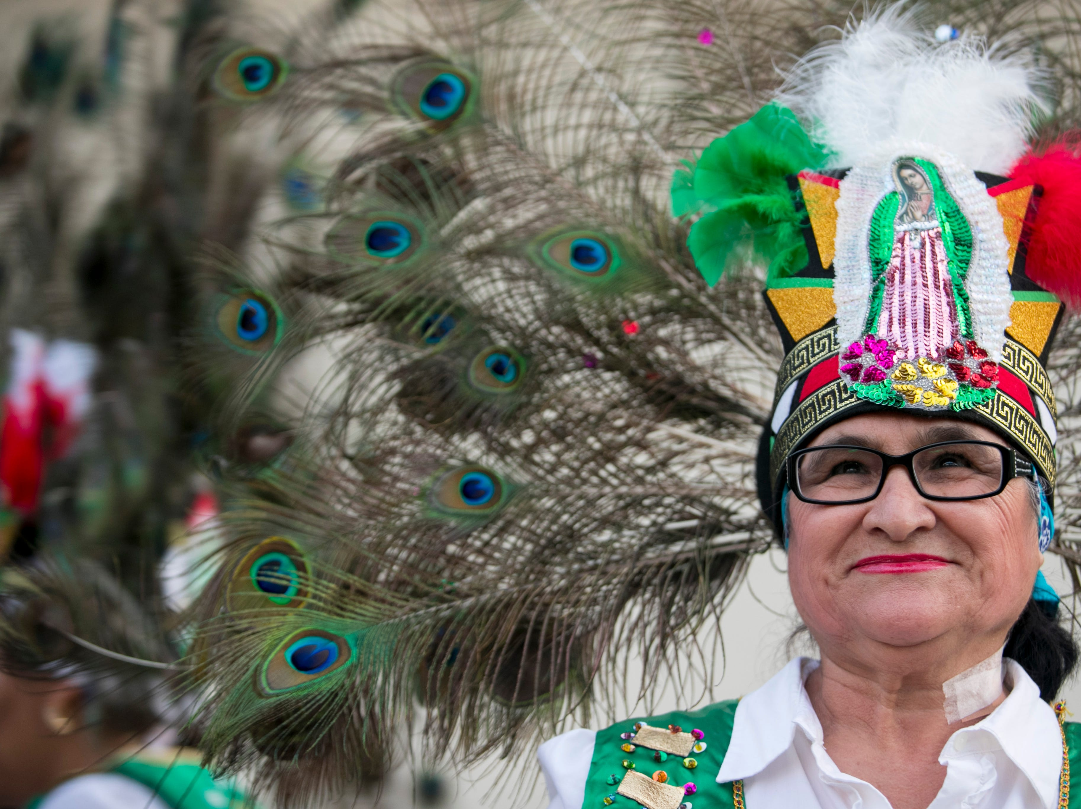 Delicia Gamez of Dance Azteca waits for the Edison Festival of Light Grand Parade to begin on Saturday, Feb. 16, 2019, at the staging area at Fort Myers High School.