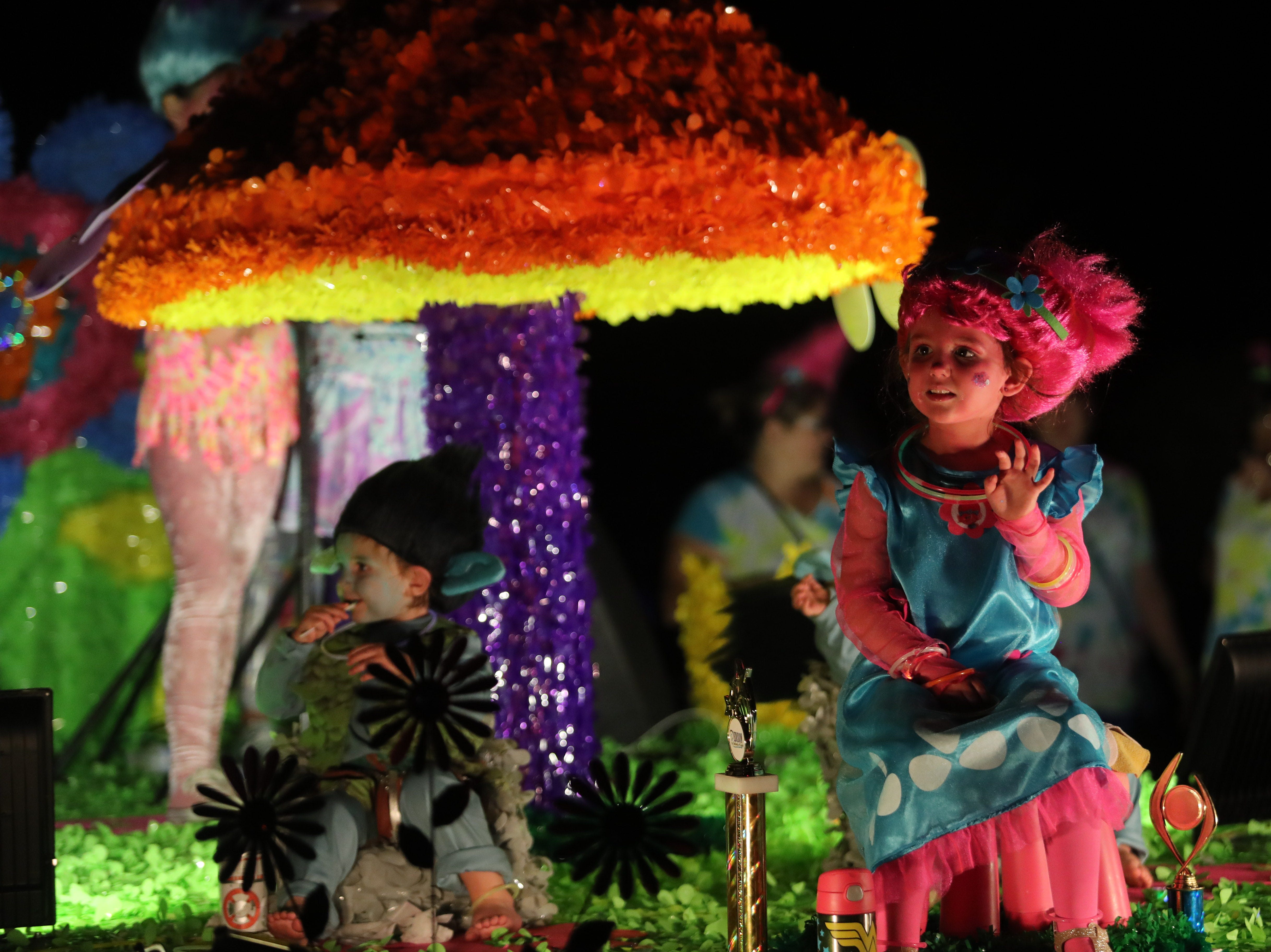 Participants in the Edison Festival of Light Grand Parade move along Cortez Boulevard in Fort Myers on Saturday, Feb. 16, 2019.