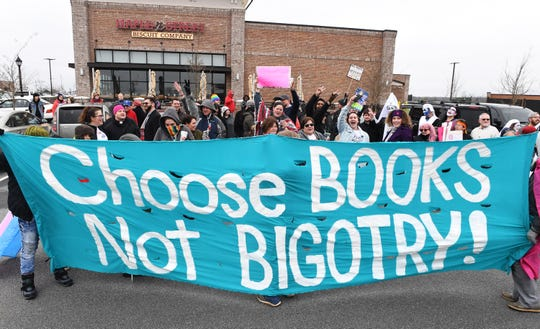 People gathered to show support for Drag Queen Story Hour at Five Forks Branch Library gather across the street Sunday, Feb. 17, 2019.