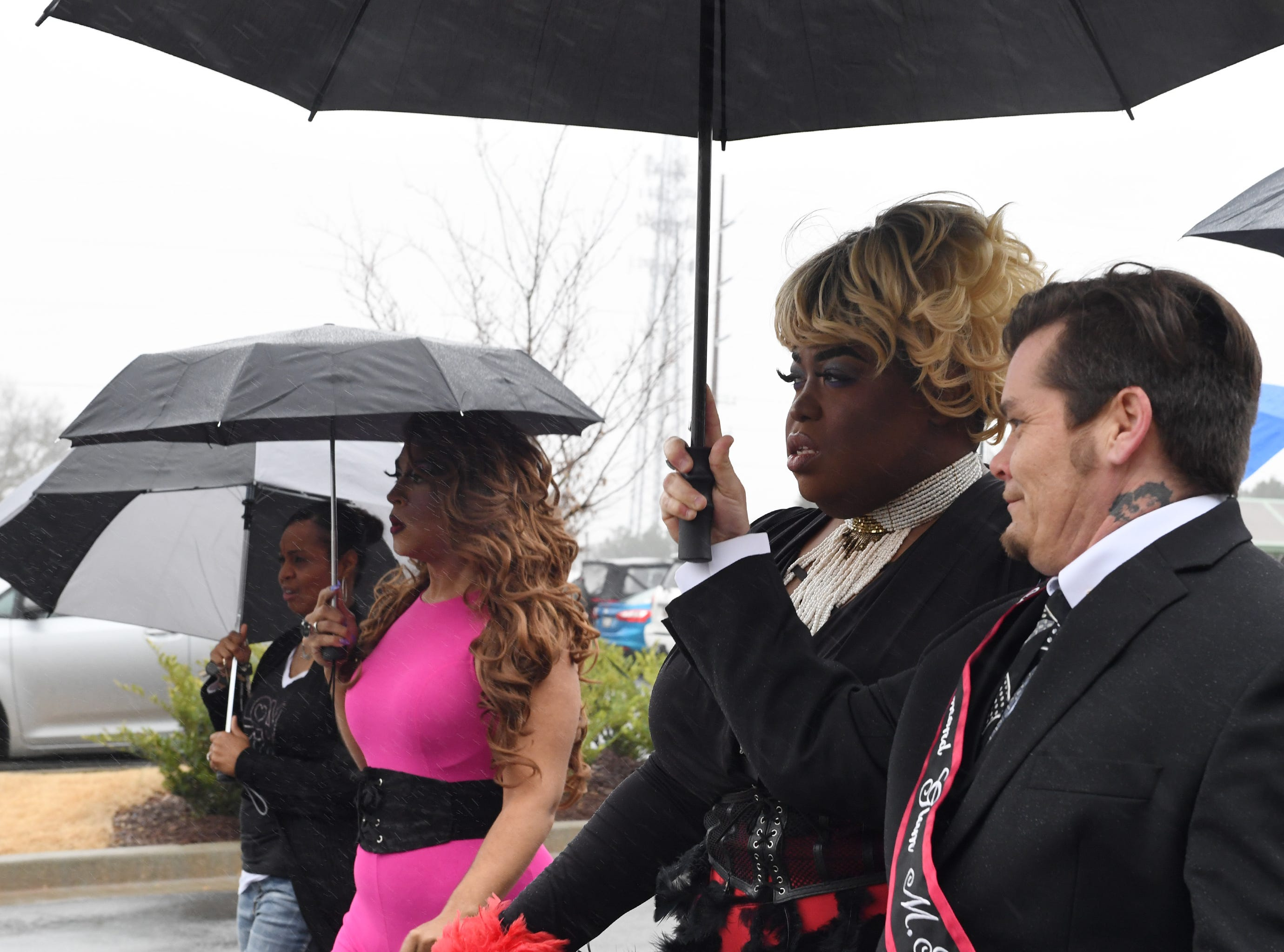 People dressed in drag walk to Five Forks Branch Library to prepare for Drag Queen Story Hour Sunday, Feb. 17, 2019.