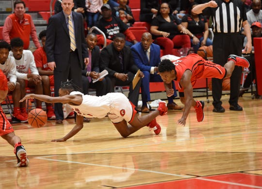 Greenville's D.J. Johnson battles for a loose ball with Westwood's Russell Jones. Greenville host Westwood in the second round of the Class AAAA boys basketball playoffs Saturday, Feb. 16, 2019.