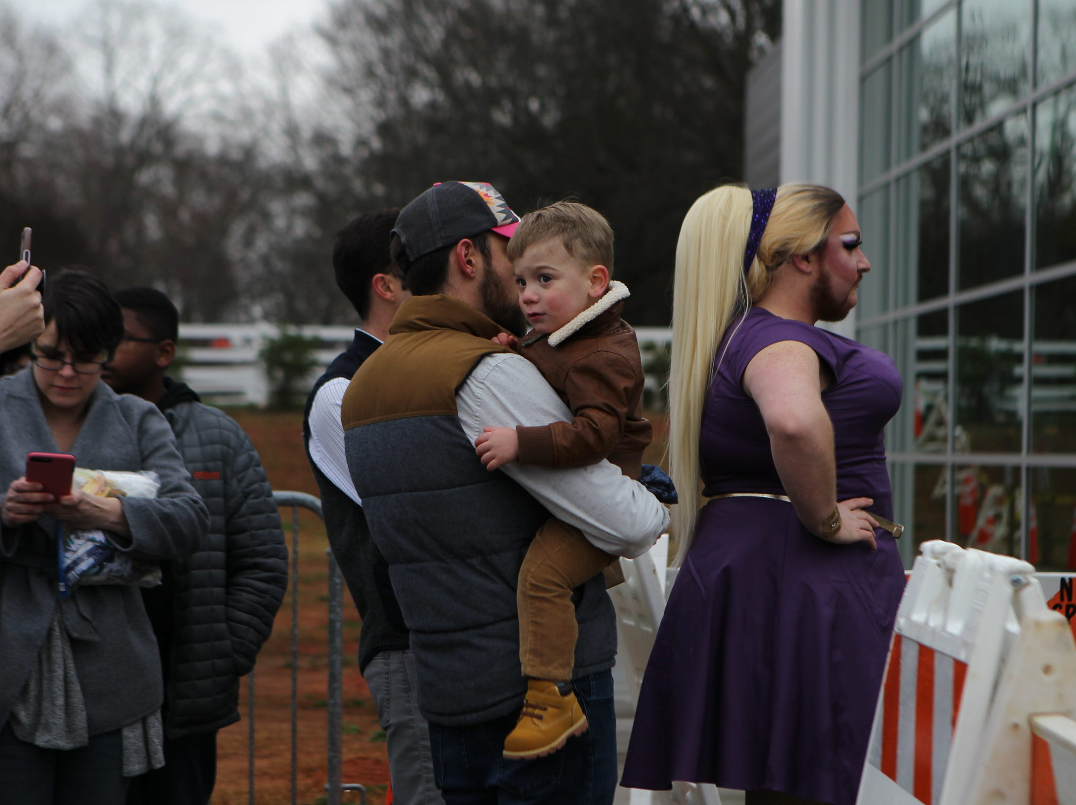 Parents with their children line up outside of Five Forks library for the Drag Queen Story Hour on Sunday, Feb. 17, 2019.