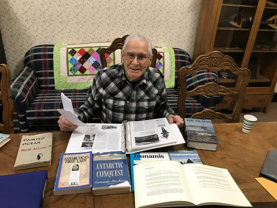 Georges de Giorgio smiles while reviewing novels and scrapbooks that detail his amazing 90 years. For the past 20 years the adventurer and historian has worked at the Ursuline Centre in Great Falls.