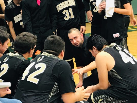 Heart Butte head coach Kellen Hall talks to his team during a timeout Saturday night at the District 10C tournament at CMR Fieldhouse. Hall's Warriors rallied ferociously in the fourth quarter to earn a victory over Great Falls Central in the championship game.