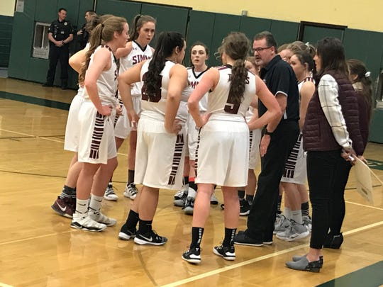 Simms head coach Truitt Kinna talks to the Tigers during Saturday night's District 10C championship at CMR Fieldhouse. Simms defeated Power 65-47. Both teams will advance to next week's Northern C combined tournament at Pacific Steel and Recycling Four Seasons Arena.
